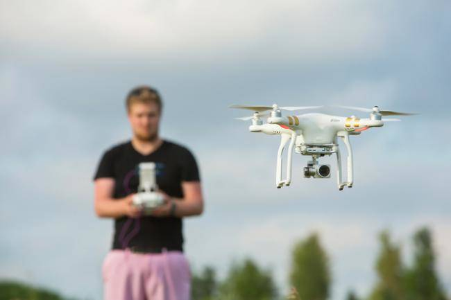 man flying DJI Phantom 3