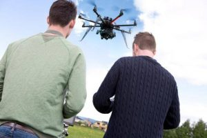 Men operating a drone with a camera