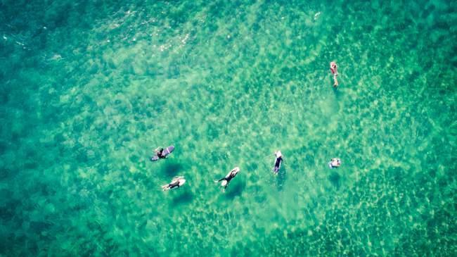 drone follows surfers